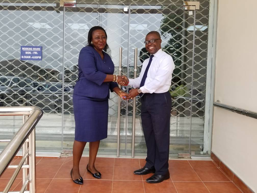 THE BOARD CHAIRMAN DR CHARLES ANANE HANDING OVER THE OFFICE KEYS TO THE MANAGERESS MAD CHRISTIANA B ATAKORA