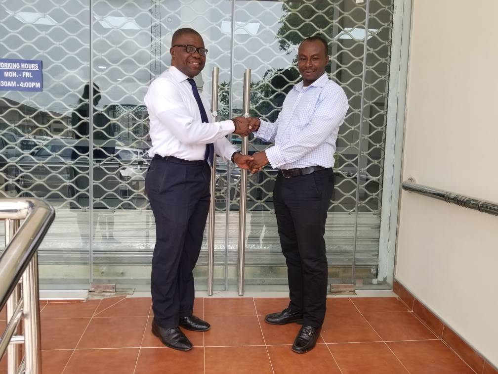 THE ESTATE MANAGER MR  FREDERICK OPPONG HANDING OVER THE OFFICE KEYS TO THE BOARD CHAIRMAN DR CHARLES ANANE