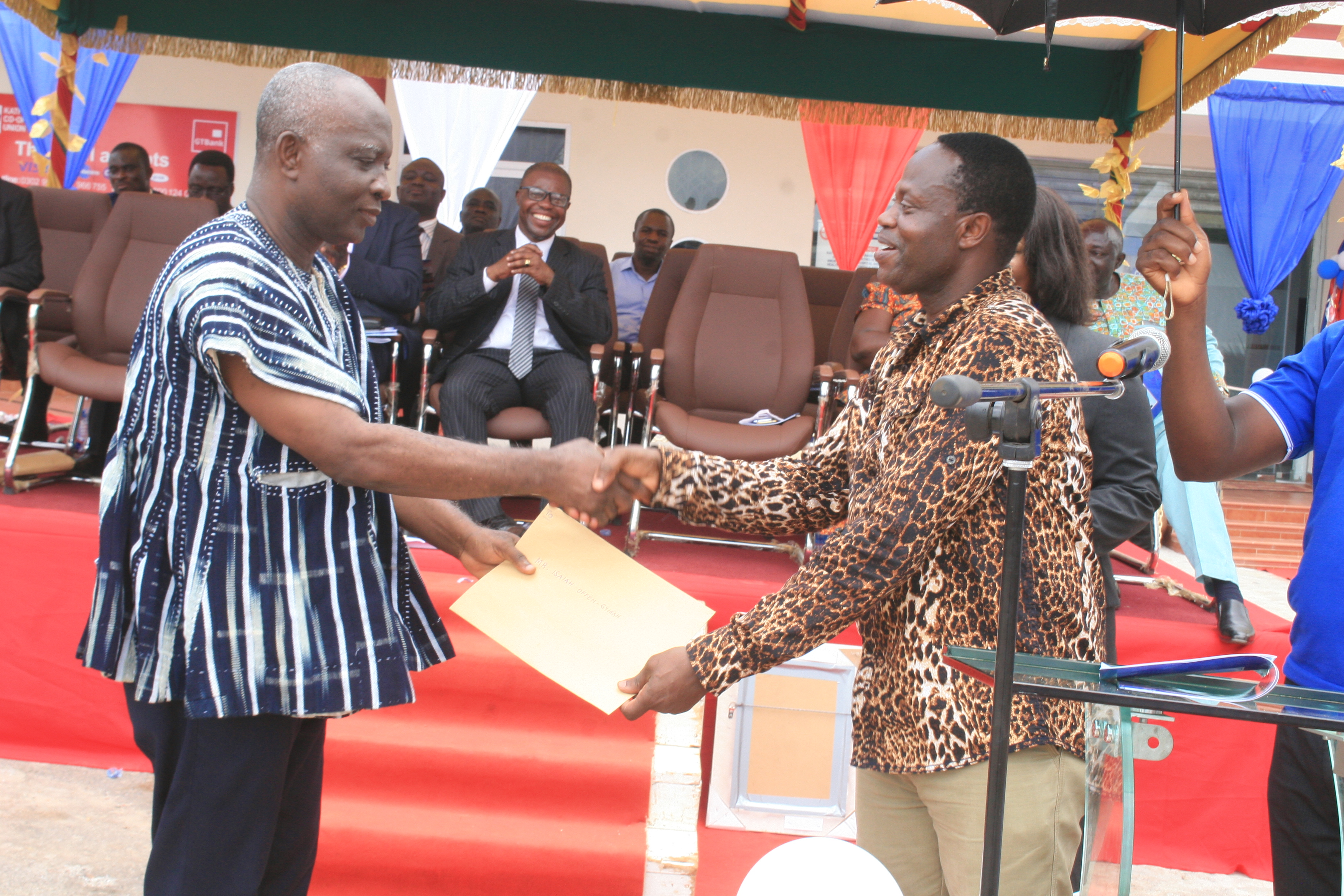 PRESENTATION TO FOUNDERS—MR CHARLES KWAKU BOATENG (REGIONAL  DIRECTOR OF CO-OPERATIVES