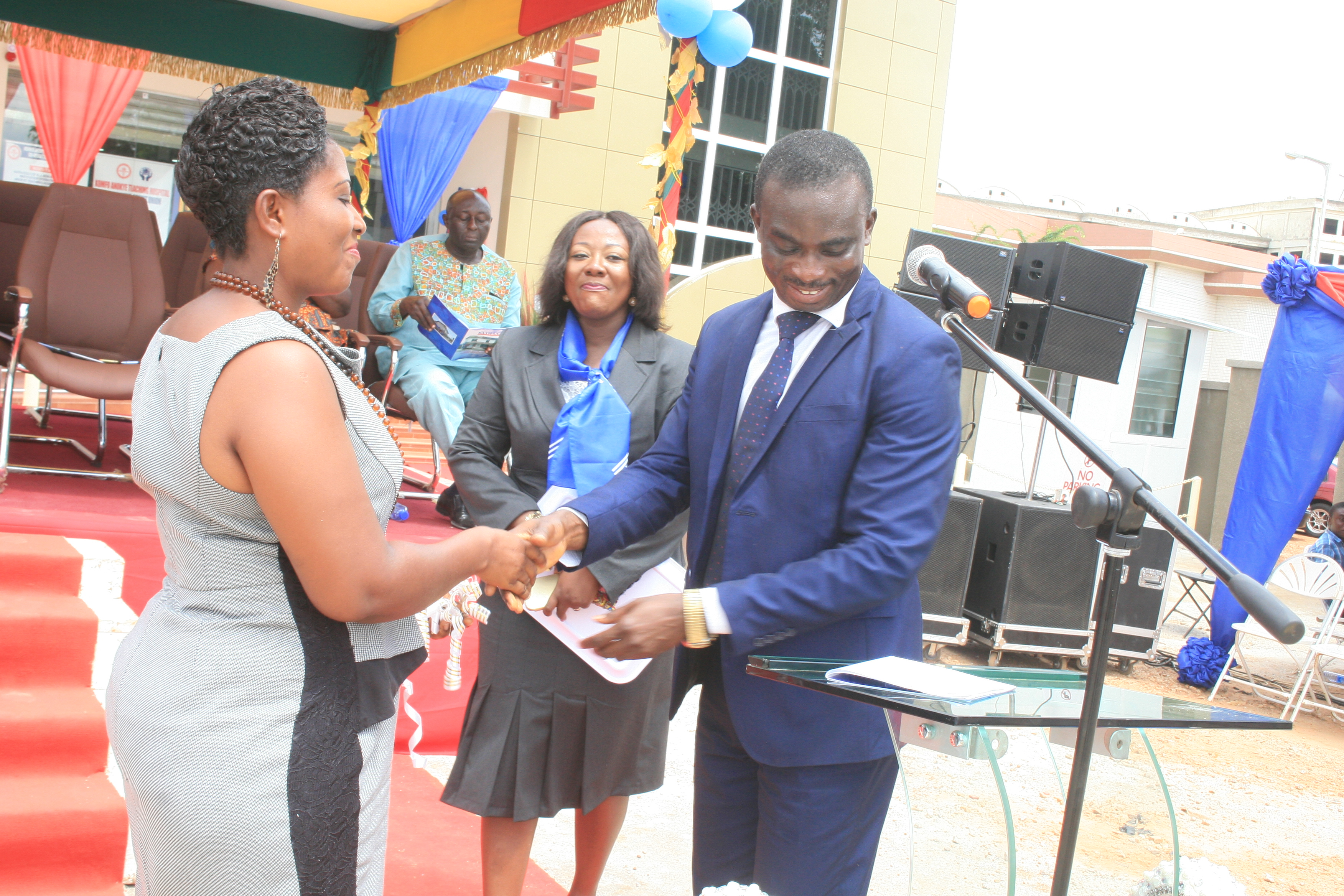 THE CONTRACTOR HANDING OVER THE OFFICE KEYS TO THE CONSULTANT MAD. ROSEMARY DWAMEN