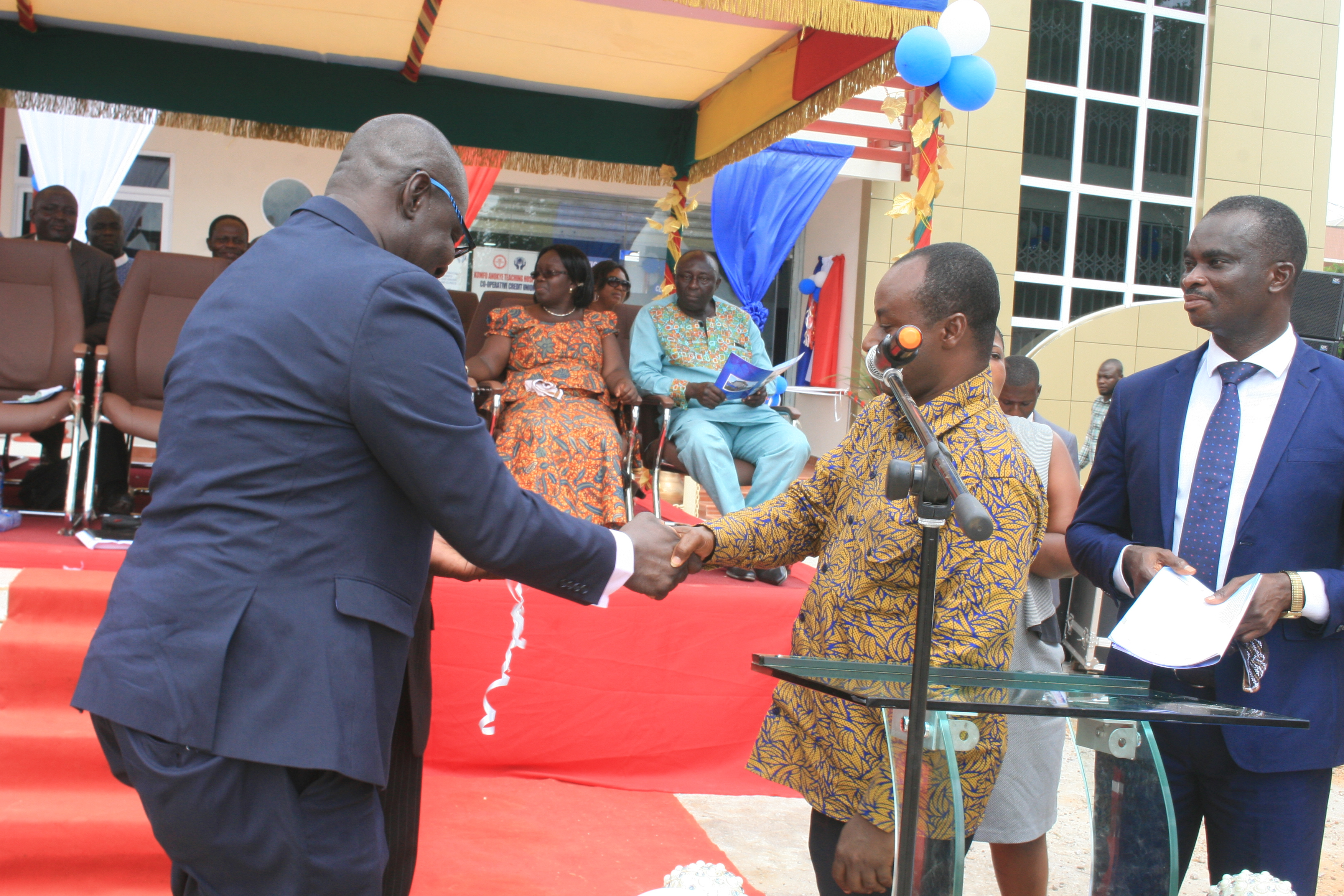 THE ESTATE MANAGER MR  FREDERICK OPPONG HANDING OVER THE OFFICE KEYS TO THE VICE CHAIRMAN DR FRANK ANKOBEA